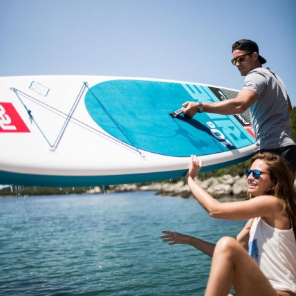 Red Paddle Co Ten Six SUP Ride launching