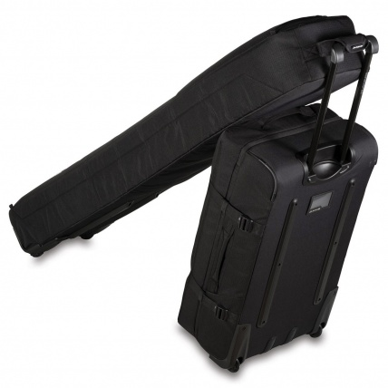 Dakine Low Roller Black Clipped to Luggage Bag