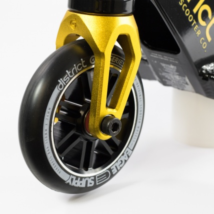 District C-Series C253 Complete Scooter in Black/ Gold front wheel close up