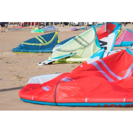 Liquid Force NV V9 Kitesurfing Kite on the beach colours