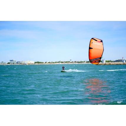 Ozone Catalyst V2 Kitesurfing Kite in orange riding